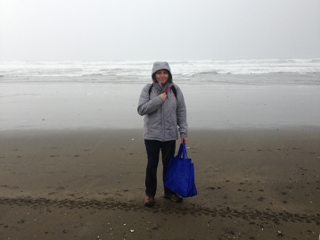 Collecting trash on the beach for a project, San Francisco, 2016