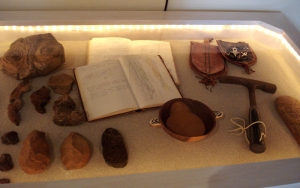 The articfacts: rocks, notebook, intruments, neolithic tools