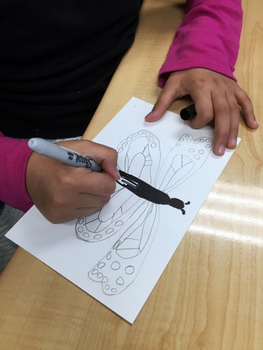 The students drew a Monarch butterfly with its very unique design, specific to the species. The quality of the lines is important in this exercise. I asked the students to really think about their lines, the way they were drawing them, to take their time.