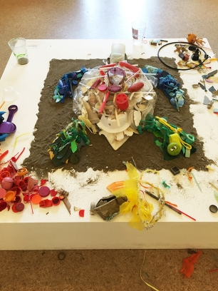 Sea turtle made of plastic debris found on California beaches in the making at the MOAH cedar.