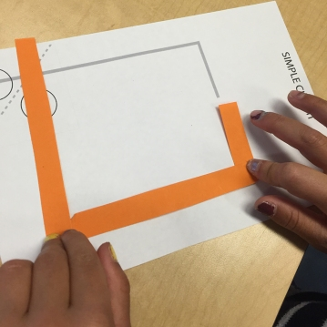 Now to the circuitry part! The students learn about simple closed and open circuits. We watched a video. They experience with folding the conductive tape to make their circuit.
