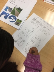 Students sketching ideas for their poster.