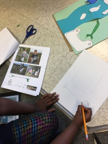 Student creating the elements for her paper cut composition.